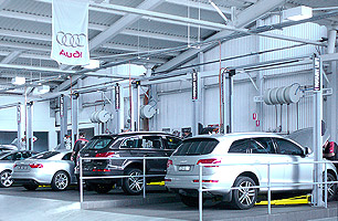 Automotive workshop fit-out with lubrication hose reels mounted in between service bays, Audi Parramatta