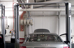 Automotive workshop fit-out with 2 post hoists and lubrication reels at end of each service bay