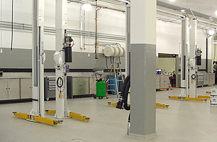 Automotive workshop fitout with 2 post hoists, lubrication reels and fume extraction system