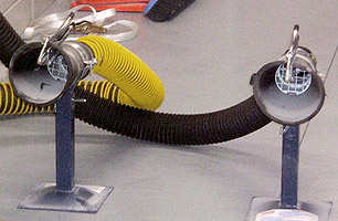 Close up of twin exhaust fume extraction for motorcycles