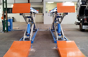 Scissor Lift in full rise position installed at SITA Environmental VIC