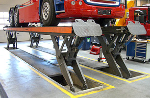 Example of in-ground semi scissor lift with Scania Prime Mover in full lift position