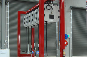 lubrication hose reels in single gantry along side prefabricated workshop pit