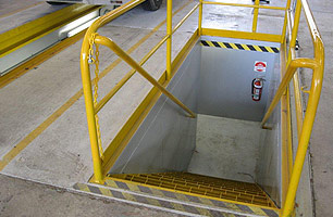 Safety hand rail installed in Bus workshop for prefabricated drop-in pit with stairs with tunnel